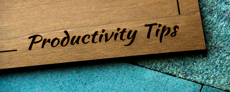 Wood board engraved with 'productivity tips'